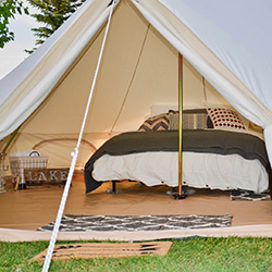 Glamping tent with bed at Wakeside Lake RV Park