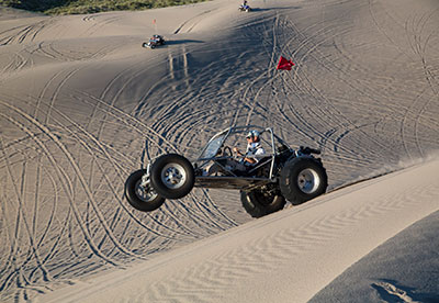 A dune buggy riding through the St Anthony Sand Dunes
