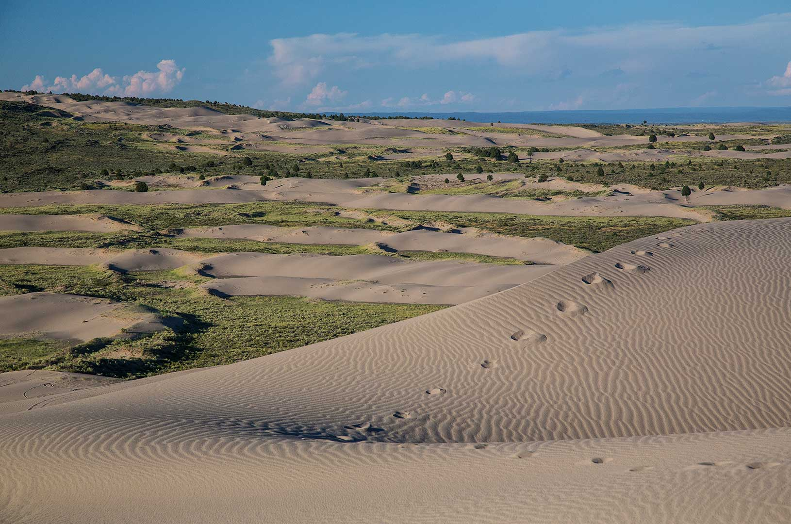 St Anthony Sand Dunes with visible footprints in the sand