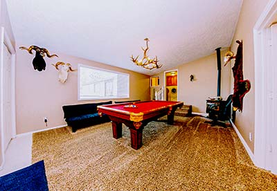 Game room at the Lakeside Lodge rental with pool table